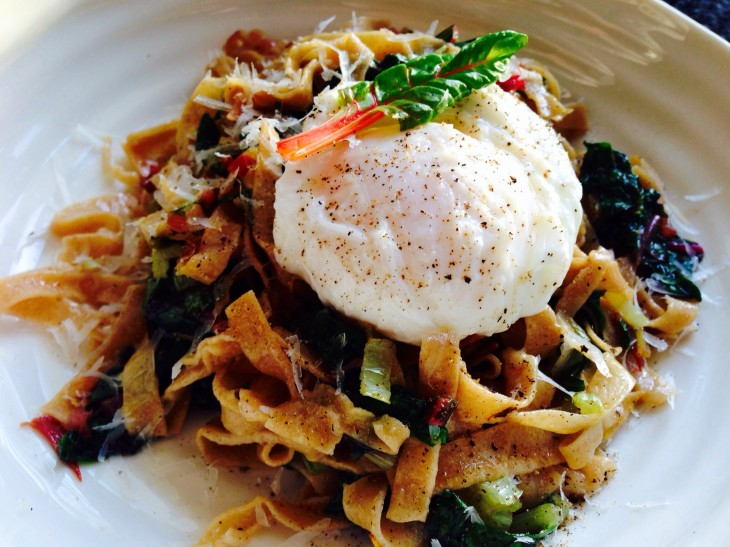 Fettuccine with chard, bacon and a soft poached egg